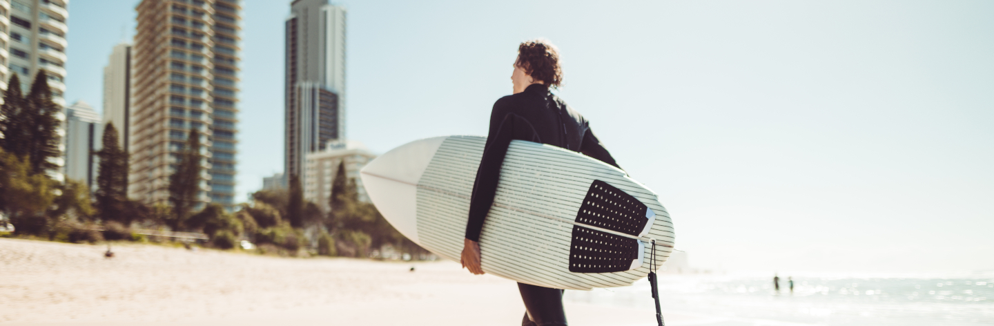 Surfer Walking In Surfers Paradise Beach In Australia