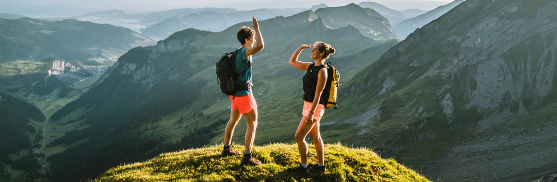 Trail Runners Ascend High Mountain Ridge